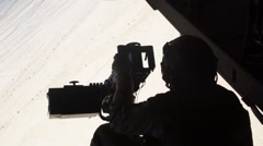 Gunner On Board Osprey Aircraft Looking Out Stock Footage