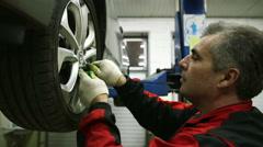 Mechanic repairing car tire - stock footage