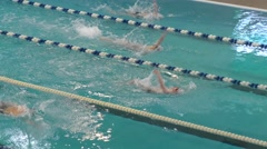 Orenburg, Russia - The boys compete in swimming on backstroke Stock Footage