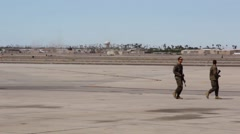 Soldiers Walk Over Airfield - stock footage