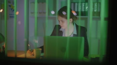 The young businesswoman works overtime - stock footage