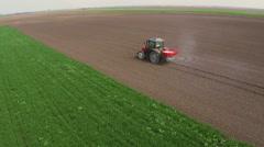 Fertilizer spreading on the field. - stock footage