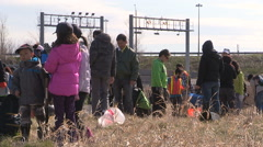 Students plant trees on Earth Day in Markham Canada v20 Stock Footage