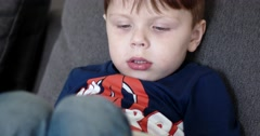 Boy Watching Cartoons on a Tablet Computer, Side View - stock footage
