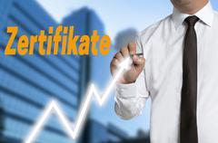 Zertifikate (in german certificates) trader draws market price on touchscreen Stock Photos