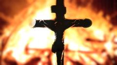 Cross detail Jesus fire macro Stock Footage