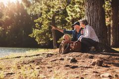 Senior man and woman on a hike in nature Stock Photos