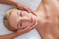 Woman enjoying beauty treatment at spa - stock photo