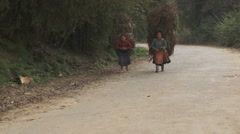 Local Hmong people carrying wood in the Bac Ha, Vietnam. Stock Footage