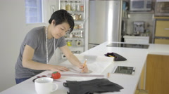 Asian woman using tracing paper to create fashioned clothes 4K - stock footage