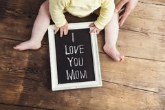 Mothers day composition. Picture frame. Wooden background. Studi Stock Photos