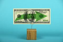 US dollar stagnation illustrated over blue - stock photo