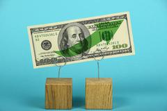 US dollar growth illustrated over blue Stock Photos