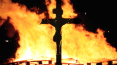 Cross detail Jesus fire night - stock footage