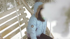 Girl on swing in forest Stock Footage