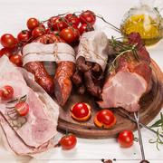 Antipasto catering platter with salami and meat on a wooden background Stock Photos