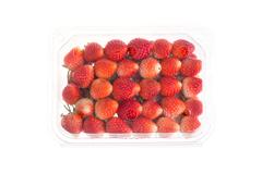 red ripe strawberry in plastic box of packaging, isolated on white background - stock photo