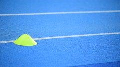 Athletes competing on a blue sprint track - stock footage
