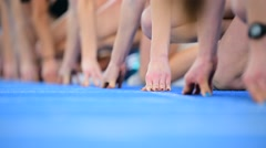 Athletes at the sprint start line Stock Footage