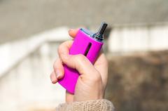 Woman holding Pink e-cig mod Stock Photos