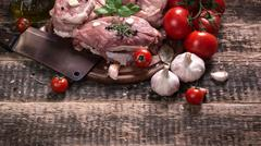 Fresh butcher cut meat assortment garnished with fresh rosemary on wooden tab Stock Photos