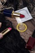 condom and lipstick - stock photo
