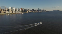 Following Boat on Hudson River Viewing Uptown Manhattan - stock footage