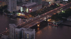 Transport interchange with road and river at night Stock Footage