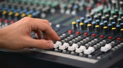 Hand adjusting professional audio mixer - stock footage
