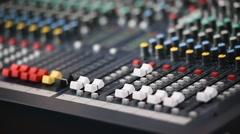 Hand adjusting professional audio mixer Stock Footage