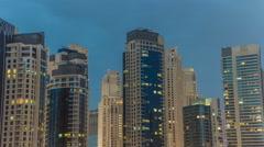 Towers of Dubai Marina in Dubai day to night timelapse Stock Footage