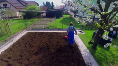Two men are preparing a new garden for planting vegetables Stock Footage