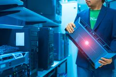 Man fix server network in data center room Stock Photos