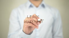 Lease Agreement   ,  man writing on transparent wall - stock footage