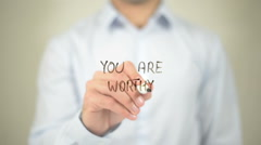 You Are Worthy   ,  man writing on transparent wall - stock footage