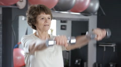Senior woman lifting dumbbells, mature, fitness Stock Footage