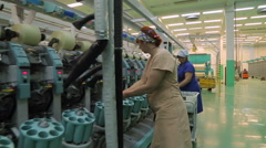 People working in a textile factory Stock Footage