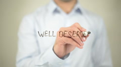 Well Deserve   ,  man writing on transparent wall Stock Footage