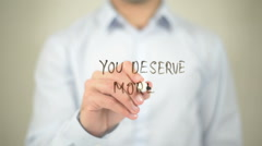 You Deserve More   ,  man writing on transparent wall Stock Footage