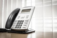Telephone on table work of room service business office Stock Photos