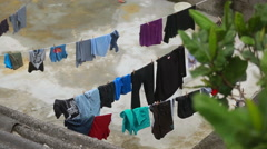 Clothes drying on the rope Stock Footage