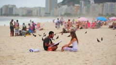 Artist painting a girl on the beach Stock Footage
