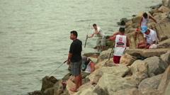 Fishermen on the Atlantic coast Stock Footage