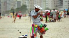Salesman on the beach Stock Footage