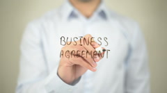 Business Agreement   ,  man writing on transparent wall Stock Footage