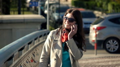 Happy woman talking on cellphone in city on bridge, super slow motion 240fps Stock Footage