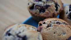Homemade wholegrain muffins with blueberry on a blue plate Stock Footage