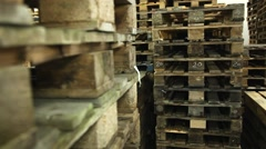 Warehouse with stacked pallets, slider shot Stock Footage