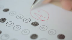 Professor puts a a perfect grade on a scantron test Stock Footage