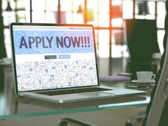 Apply Now on Laptop in Modern Workplace Background Stock Illustration